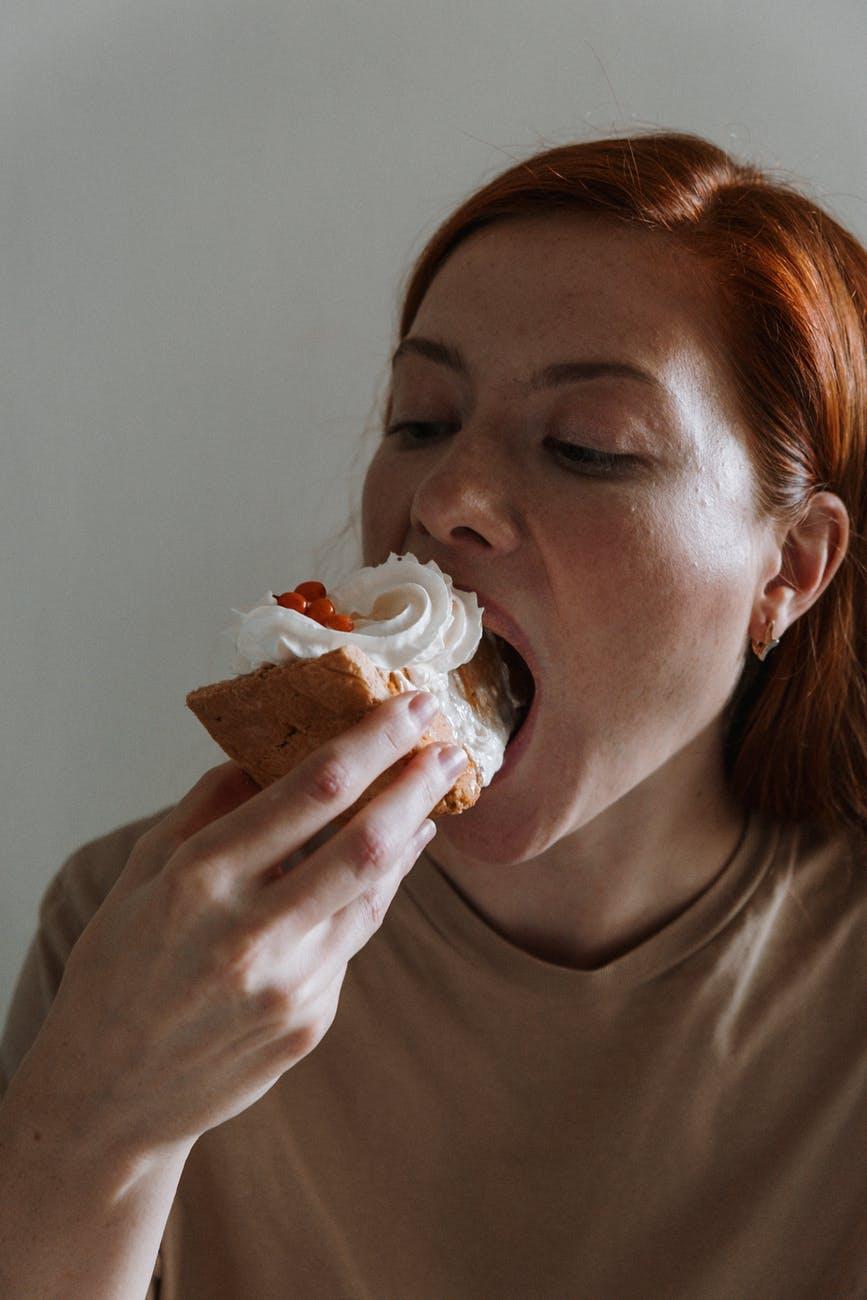 woman eating a pumpkin pie